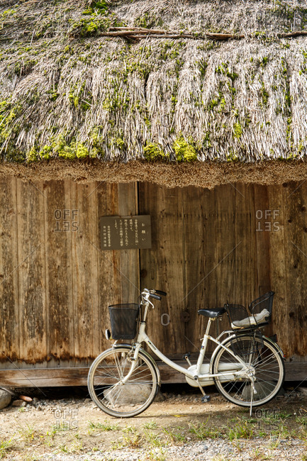 October 6, 2016 - Hokuriku, Japan: Bicycle outside a traditional gassho-zukuri 