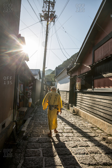 October 6, 2016 - Hokuriku, Japan: Man in a kimono walks down a street in Giju town