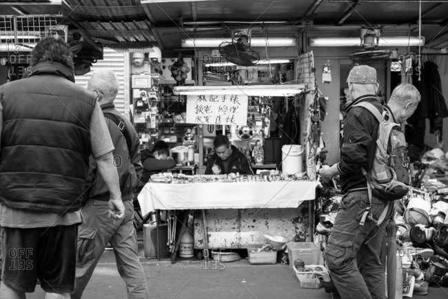 January 20, 2017 -  Hong Kong: A watchmaker on a busy market street in Sham Shui Po