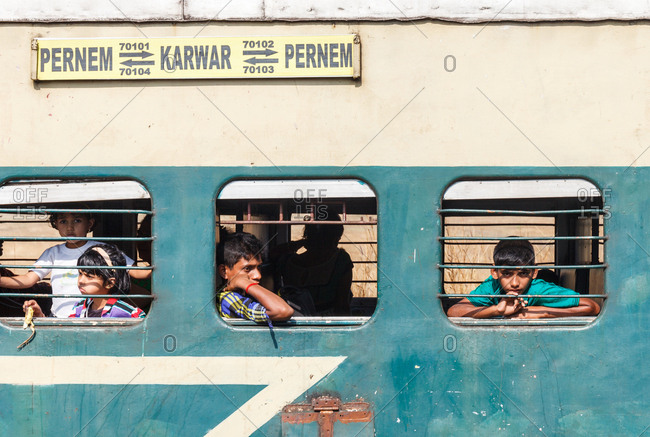 December 26, 2015 - Goa, India: People in the windows of a train in South India