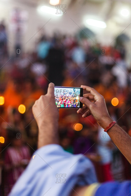 November 19, 2015 - Pushkar, India: Smartphone photographing a colorful festival crowd