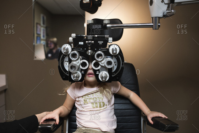 Young girl getting an eye exam