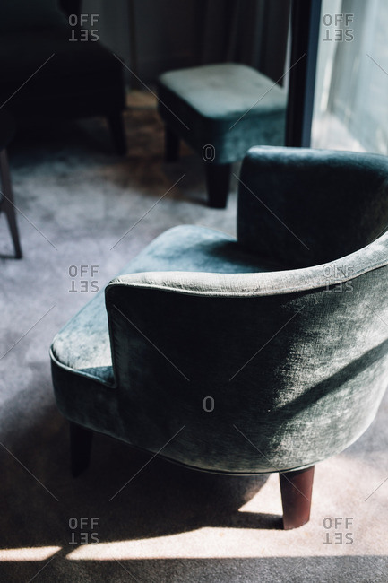 A rounded upholstered armchair