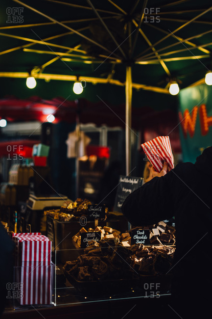 Sweets vendor at outdoor market, London