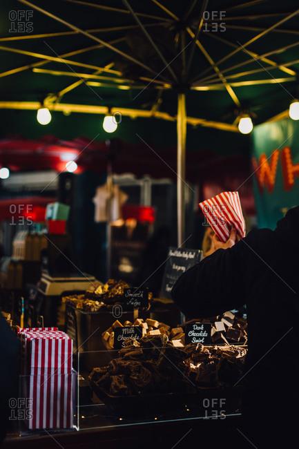 Sweets vendor at outdoor market, London