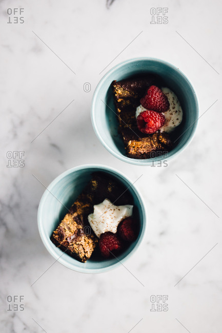 Brownie with cream and raspberry