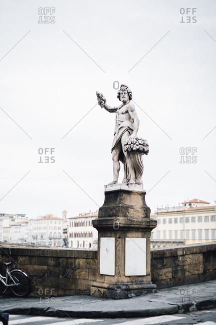 Statue on corner of bridge, Florence, Italy
