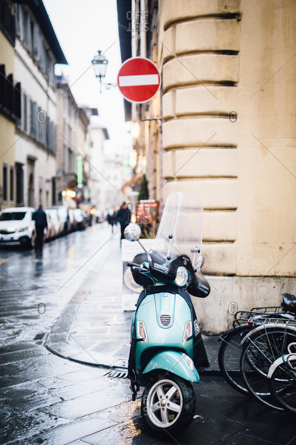 Florence, Italy - February 4, 2017: Moped on corner of a street
