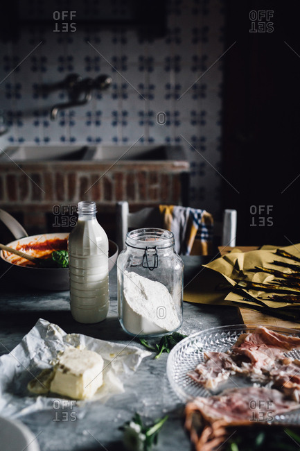 Milk and flour on cluttered table