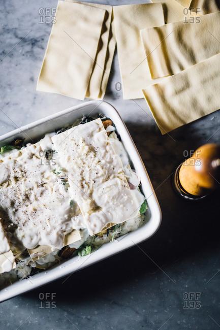 A raw lasagna with creamy top
