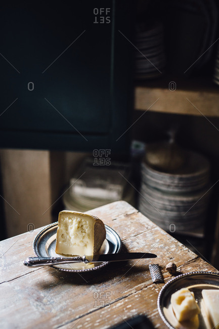 Aged cheese on silver plate