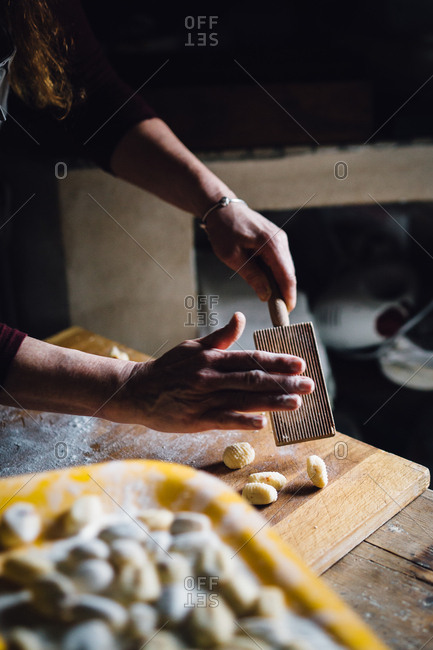 Person making gnocchi in kitchen