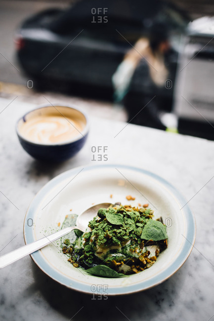 A salad with a coffee