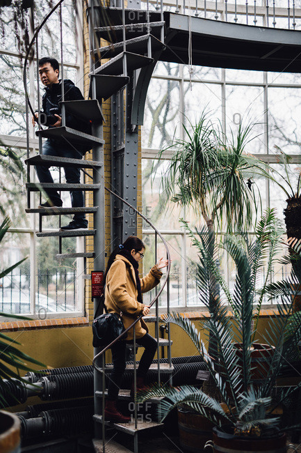 Amsterdam, Netherlands - February 26, 2017: People exploring in botanical greenhouse