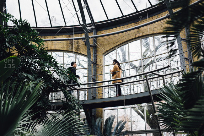 Amsterdam, Netherlands - February 26, 2017: People exploring in a botanical greenhouse