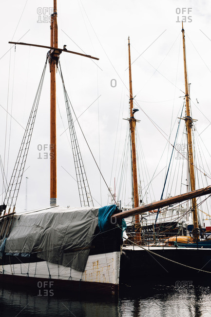 Faroe Islands, Denmark - March 11, 2017: Sailboats moored to shore