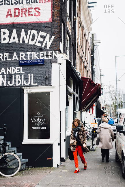 Amsterdam, Netherlands - March 17, 2017: People by restaurants in street