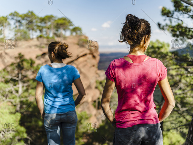 Two women looking at mountain view in Albarracin, Spain