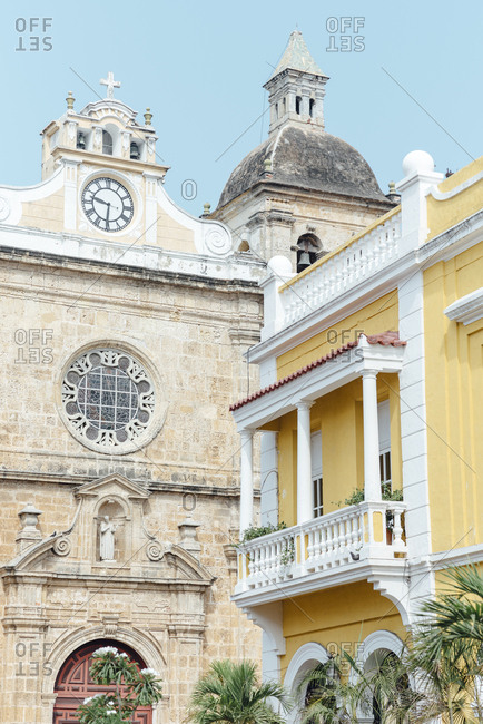 Corner view of the cathedral beside a colonial house in the walled city in Cartagena de Indias, Colombia