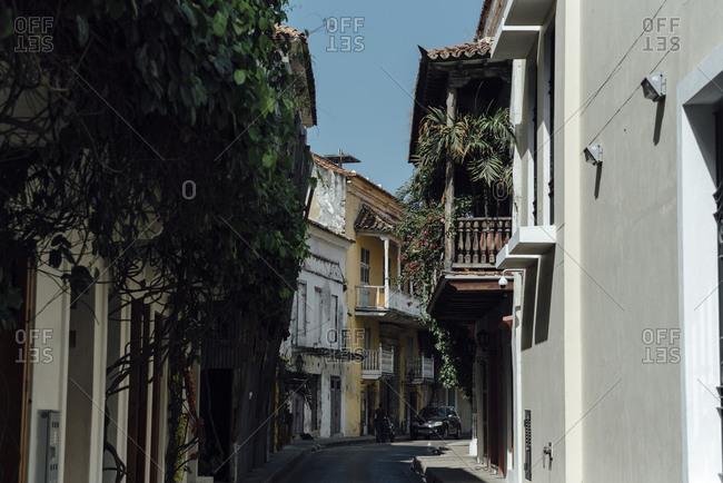 Narrow street in the walled city of Cartagena de Indias, Colombia