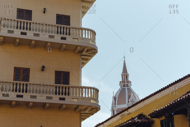 Colonial balconies beside a church in the walled city of Cartagena de Indias, Colombia