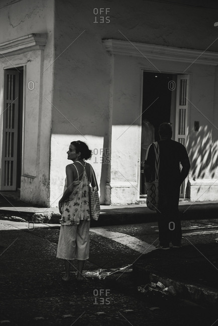 Woman walking in one of the walled city streets in Cartagena de Indias, Colombia