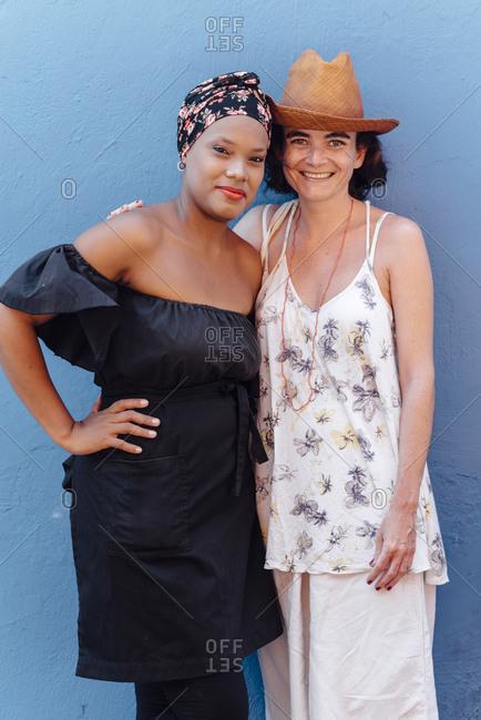 Cartagena de Indias, Colombia - March 04, 2017: Tourist posing next to a Caribbean woman in Cartagena de Indias, Colombia