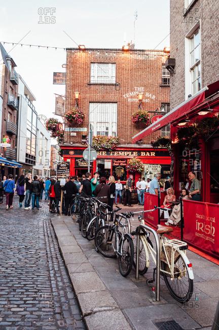 Dublin, Ireland - June 29, 2013: People outside Temple Bar