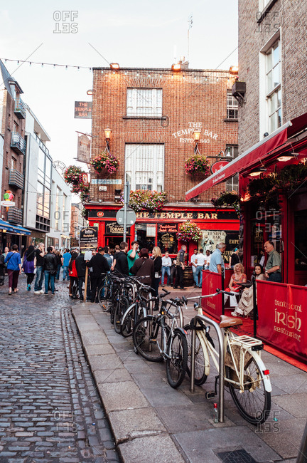Dublin, Ireland - June 29, 2013: People outside Temple Bar