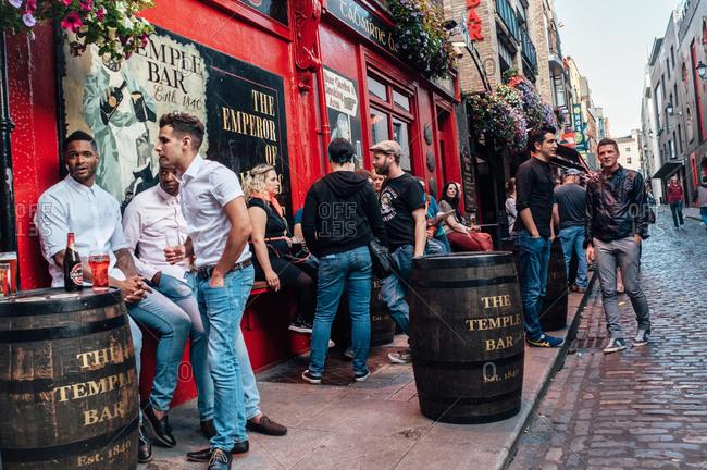 Dublin, Ireland - June 29, 2013: Hip crowd outside Temple Bar