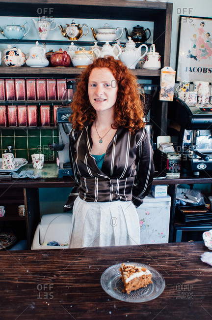 County Galway, Ireland - June 27, 2013: Red haired server in caf�