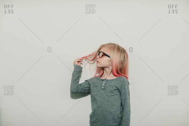Girl looking at pink hair