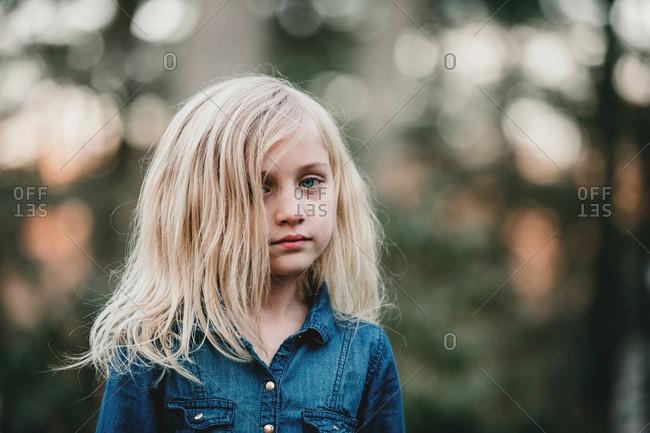 A girl in a denim shirt