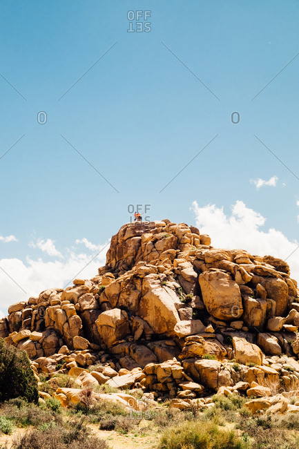People on a rock mound