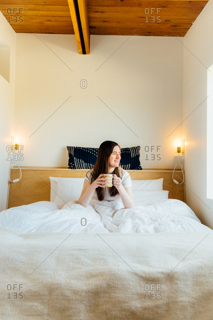 March 26, 2017: Woman sitting in bed with a mug