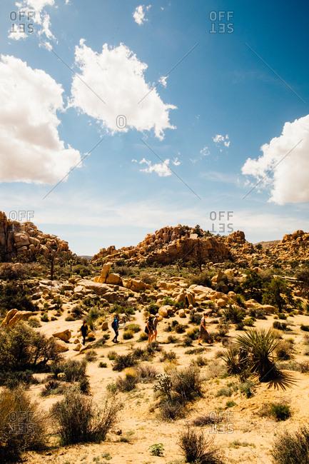 March 25, 2017: People exploring a desert plain