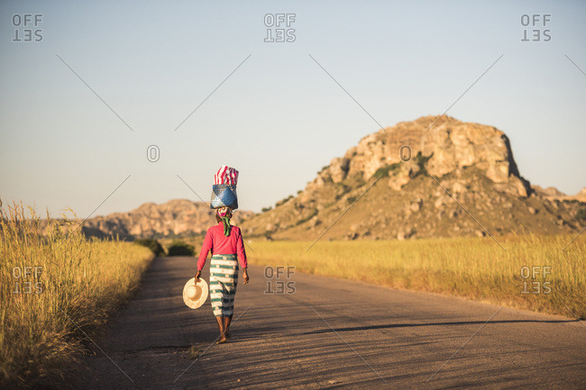 Madagascan Woman balancing goods on her head