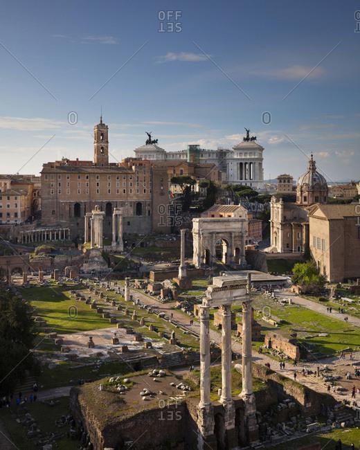 Rome, Roma district, Latium, Italy - April 23, 2016: Roman Forum with view towards to Campidoglio Palace and Vittoriano