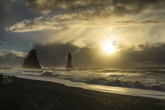The sun is rising at the beach of Reynisfjara