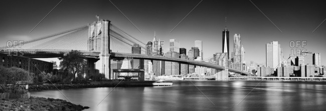 New York City,  USA - August 8, 2016: Brooklyn Bridge, View from Dumbo towards Lower Manhattan and Financial District skyline