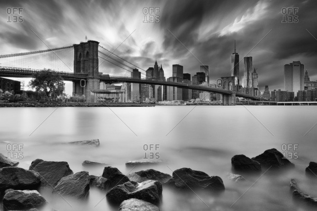 New York City,  USA - August 8, 2016: Brooklyn Bridge, View of the Lower Manhattan and Financial District skyline across the East River