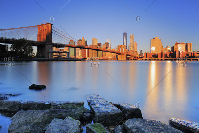 New York City, USA - March 17, 2015: Brooklyn Bridge, View from Dumbo towards Lower Manhattan and Financial District skyline with Brooklyn Bridge and Freedom Tower in the background