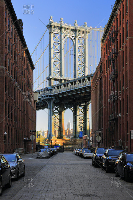 New York City,  USA - March 17, 2015: Manhattan Bridge from Dumbo, Empire State Building in the far ground