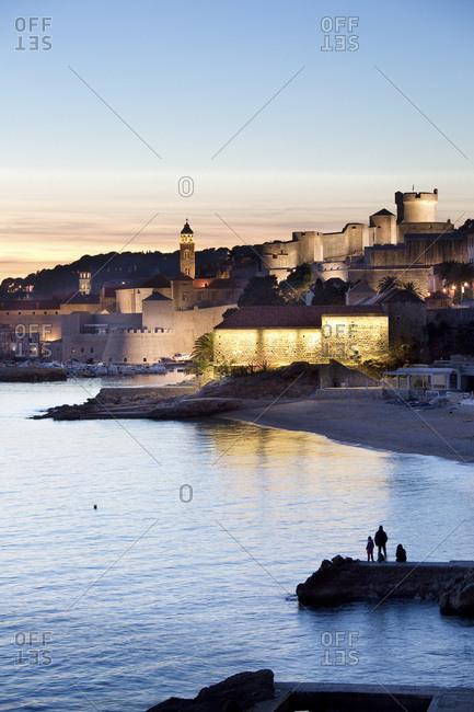 Banje beach at dusk and the city walls