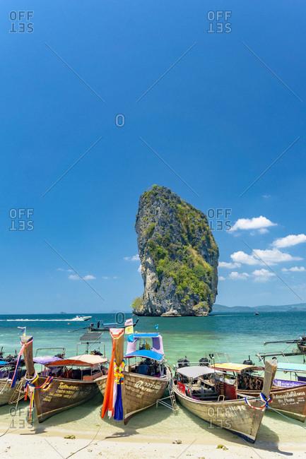 Krabi, Poda island, Thailand - March 7, 2016: Long tail boats on Poda Island beach