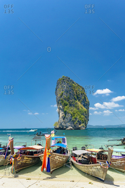 Krabi, Poda island, Thailand - March 7, 2016: Long tail boats on Poda Island beach