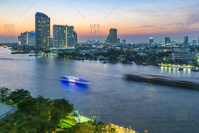 Bangkok,  Thailand - March 6, 2016: Skyline of the city along Chao Praya river