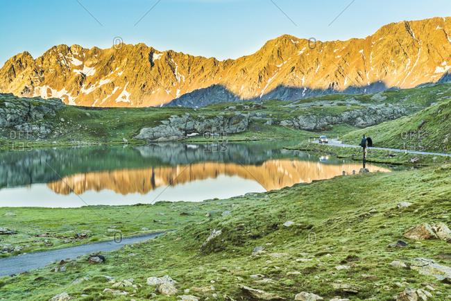 White lake at sunrise wih mountains reflex inside Valfurva at Gavia Pass