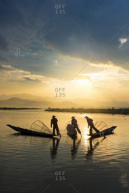 Taunggyi district, Three local fishermen in silhouette at sunrise
