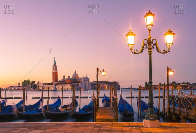 Riva degli Schiavoni, moored gondolas in front of San Giorgio Maggiore church